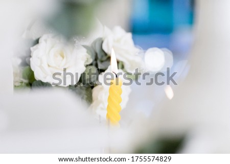 Picture of white flowers and decorative flame candles for weddings