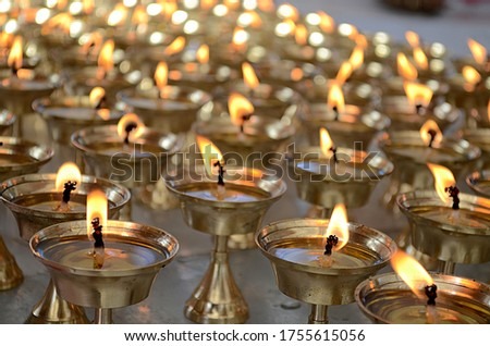 Many lamps are burning in the temple
