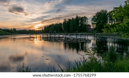 summer picture with beautiful colorful sunset over the lake, a wonderful place of strength and energy, peace, harmony and quiet