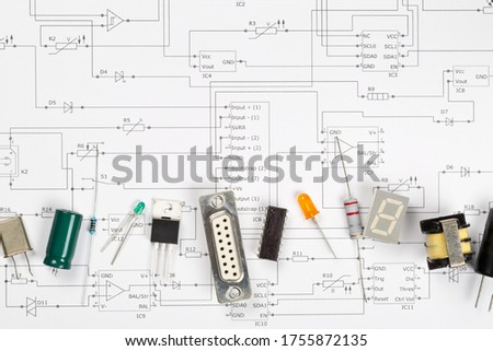 Different electronic parts or components on pcb wiring scheme background with resistors, capacitors, diode and ic chips, flat lay top view from above with copy space #1755872135