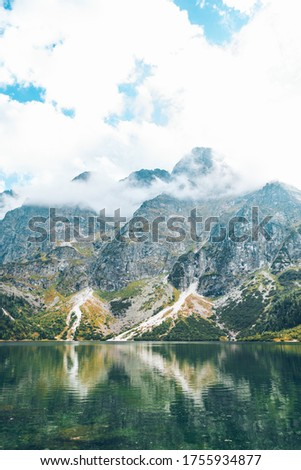 landscape view of autumn lake in mountains