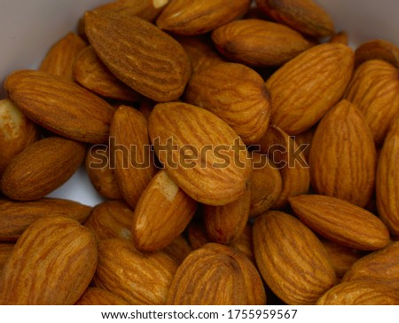 Raw Shelled Almonds, reddish Brown cover nuts Top view, dry fruit Primary Ingredient Food Image #1755959567