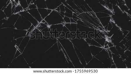 Cracked screen phone texture banner background.Broken glass with cracks. Abstract of cracked screen Smartphone from shock.Dark black and white colors.