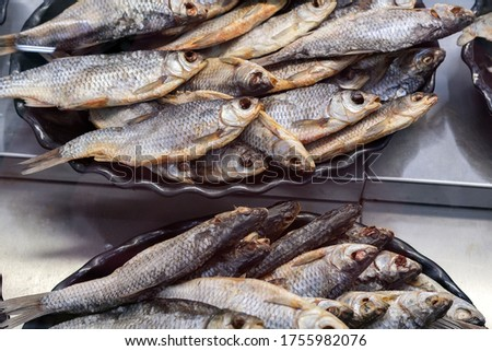 dried fish roach, Rudd. lies on the counter in the market, salty snacks. roach
