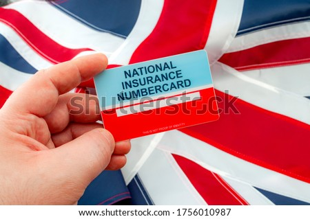 Social security system, access to safety net programs in Great Britain concept theme with a blank National Insurance Number card or NINO held in one hand with the UK flag in the background Royalty-Free Stock Photo #1756010987