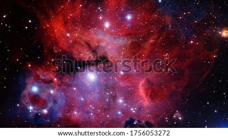Red nebula in space, abstract background. Elements of this image furnished by NASA
