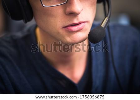 Interpreting - Male interpreter  simultaneous interpreter booth (shallow DOF) Royalty-Free Stock Photo #1756056875