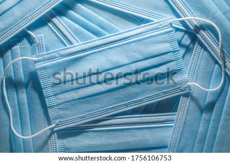 Pile of disposable personal protective equipment, PPE, medical face masks. Royalty-Free Stock Photo #1756106753