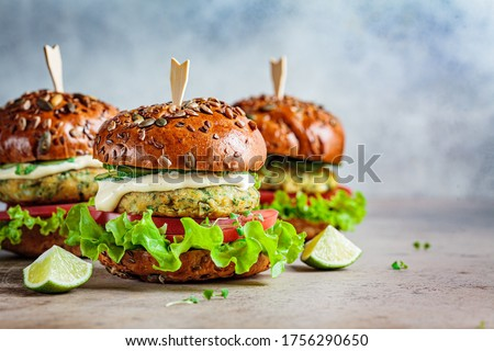 Vegan falafel burger with vegetables and sauce, dark background. Healthy food concept. Royalty-Free Stock Photo #1756290650