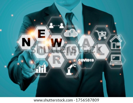 Businessman touching new normal wording with icon such as online shopping social distancing work from home and COVID19.The world is changing to balance it into new normal include business , economy ,  Royalty-Free Stock Photo #1756587809