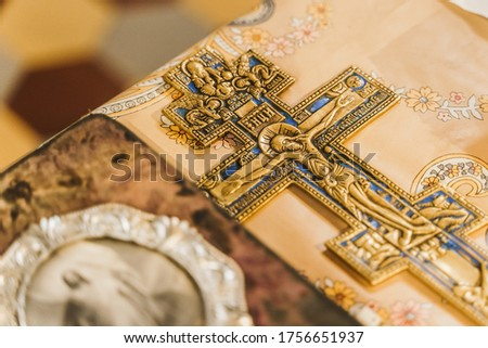 Orthodox cross and holy book with picture of Jesus Christ on the table in church. Orthodox faith. Equipment for praying. Pray for people life. Pray to god