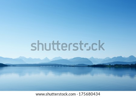 Remote view at the Atlantic Ocean Road, Norway. Misty mountain landscape in the hazy weather. Royalty-Free Stock Photo #175680434