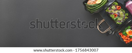 Healthy meal diet plan daily ready menu black background, fresh dishes in paper boxes, smoothie, fork knife on paper eco bag as food delivery service at home in office, flat lay, website photo banner. #1756843007