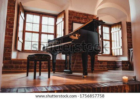 Grand piano in a rustic room