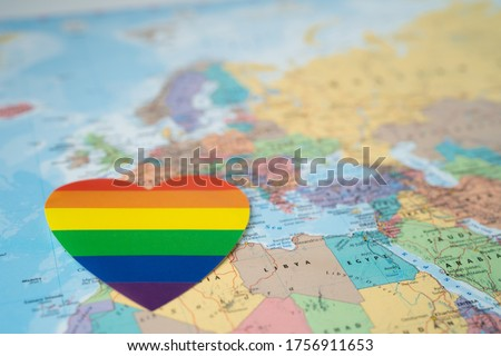 Rainbow color heart on Europe globe world map background, symbol of LGBT pride month  celebrate annual in June social, symbol of gay, lesbian, bisexual, transgender, human rights and peace.