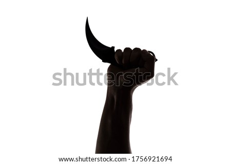 Hand holding a contact knife very hard on white background. dramatic lights Royalty-Free Stock Photo #1756921694