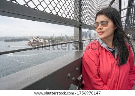 Traveller travel and relax at Sydney harbour bridge, Australia. Aerial view of modern high building in business district area in New South Wales , Australia. Royalty-Free Stock Photo #1756970147