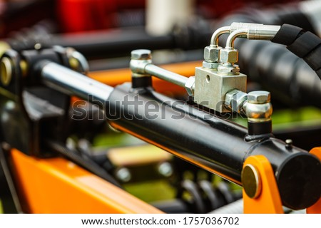 Hydraulic system on modern heavy machine. Industrial detail piston in machinery. Technology. Royalty-Free Stock Photo #1757036702