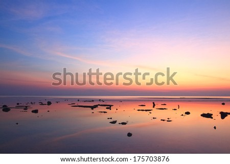 Sunset sky reflection over clear sea  #175703876