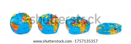 Planet earth deflating isolated on panoramic white background. Earth overshoot day, unsustainable resources consumption concept Royalty-Free Stock Photo #1757135357