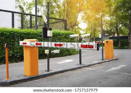 Automatic Barrier Gate , Security system for building and car entrance vehicle barrier                                      Royalty-Free Stock Photo #1757137979