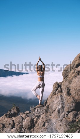 Woman enjoying nature. Female doing the yoga pose on background of natural landscape of mountains and sky. Mount Teide, volcano on Tenerife, Spain, Europe. Concept of vitality, zen energy, meditation. #1757159465