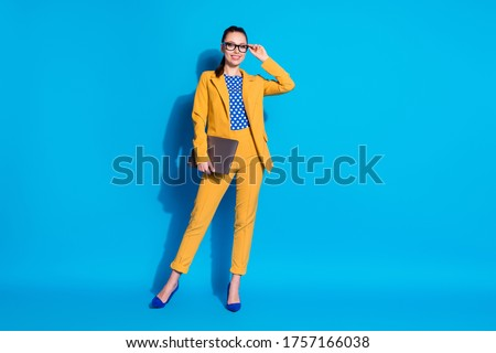 Full length body size view of her she nice-looking attractive classy chic gorgeous lady leader shark touching specs holding in hand laptop isolated bright vivid shine vibrant blue color background #1757166038