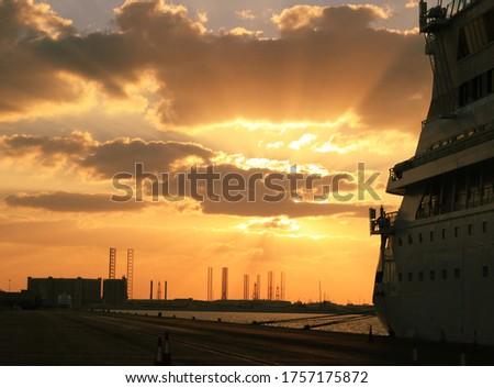 sunset exploding right behind a cruiseship