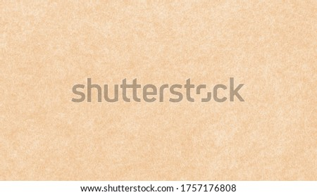 Closeup of felt background fabric texture in cream beige colors that mean warm, calm, relaxing and comfort . Pale brown felt material in High resolution photo.