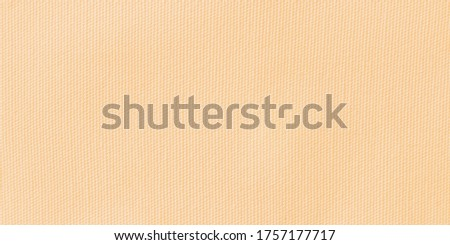 Closeup of canvas background fabric texture in cream beige colors that mean warm, calm, relaxing and comfort . Pale brown cloth material in High resolution photo.