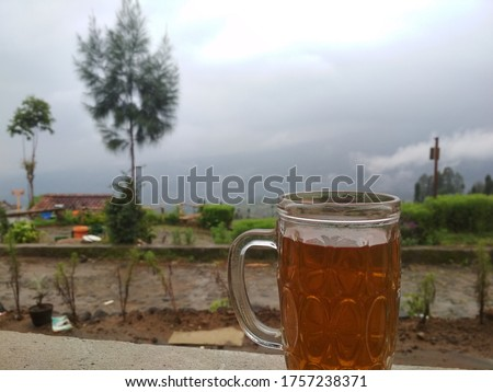 A Glass Of Tea with Fog in the Background #1757238371