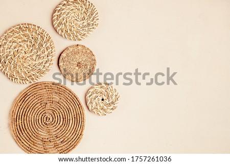 Rattan basket wall decor bohemiam style. Eco friendly trendy room decoration. Copy space Royalty-Free Stock Photo #1757261036