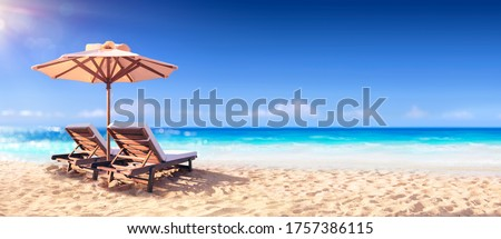 Two Chairs And Parasol With Blurred Sea Background Royalty-Free Stock Photo #1757386115