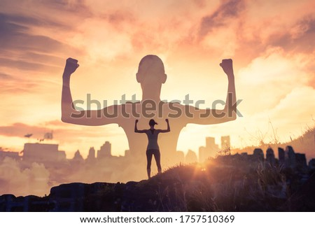 Strong fearless woman in the city. People power and mental strength concept.  Royalty-Free Stock Photo #1757510369