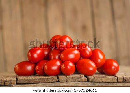 Fresh aromatic plum tomatoes. Plum organic tomatos on market. Italian plum tomatoes. Young juicy tomatoes. Farm market tray full of tomatoes. #1757524661
