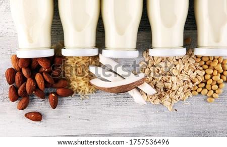 Various vegan plant based milk alternatives and ingredients. Dairy free milk substitute drink, healthy eating.  Royalty-Free Stock Photo #1757536496