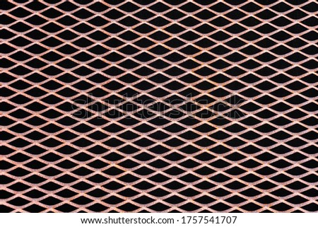 Rusty metal grid with geometric pattern of rhombi, background