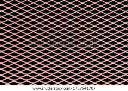 Rusty metal grid with geometric pattern of rhombi, background