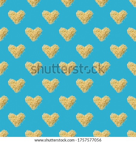 instant noodles heart symbol seamless pattern over blue background. backdrop texture. fast food concept.