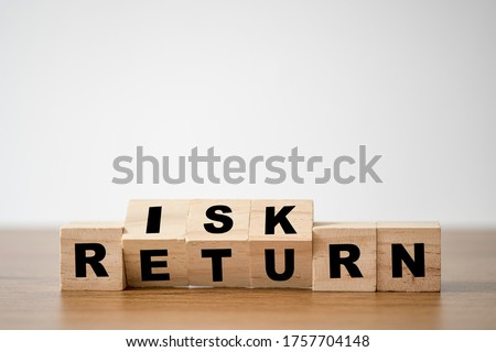 Flipping of wooden cubes block which print screen risk and return wording. Investment concept about balance between risk and return. Royalty-Free Stock Photo #1757704148