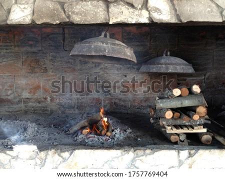"Traditional way of preparing food, ""Peka"". Picture taken on island of Premuda, Kornati islands, Croatia"