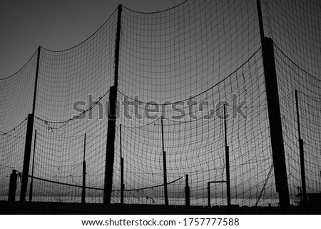 Net of a beach volleyball court at sunset #1757777588