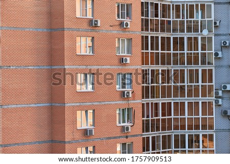 Multistorey building with new modern apartments. Multi-storey facade, living block of flats. Renting an apartment in high raised building #1757909513