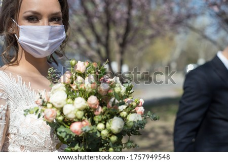 bride and groom in protective masks. Wedding during the period of quarantine and pandemic Covid 19-20, coronavirus wedding. The groom and the bride in wedding dresses, with dresses in protective masks #1757949548