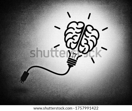 Creative brain idea concept with lightbulb and usb cable
