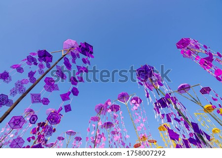 Polygon color swatch made from multicolored thread tied in bunches on bamboo poles To decorate in the Buddhist festival
