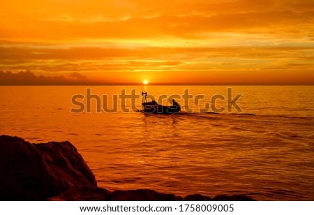 Orange sunset river boat silhouette. Sunset boat silhouette. Sunset boat view #1758009005