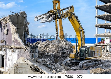 Building House destruction Demolition site Excavator with hydraulic crusher machine ruin house Royalty-Free Stock Photo #1758011072
