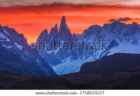 Sunset mountain peaks snow landscape. Mountain peak snow sunset view. Sunset mountain peak snow panorama #1758033257