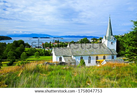 Rural country church view. Mountain lake village church landscape. Rural church view #1758047753